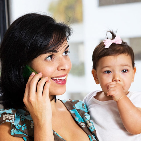 Woman on the Phone with a Baby